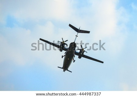 Flying private propeller-driven airplane Piaggio P.180 Avanti over blue sky - stock photo