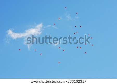 Flying red balloons on the beautiful blue sky background. Vilnius. - stock photo