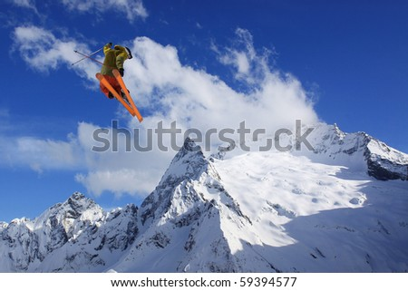 flying skier on mountains - stock photo