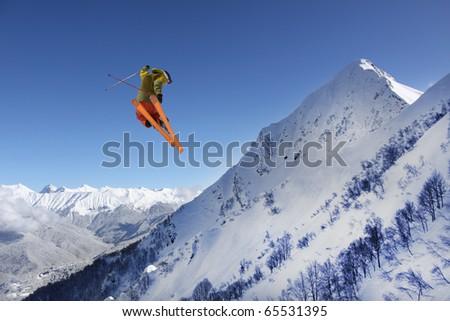 flying skier on mountains - stock photo