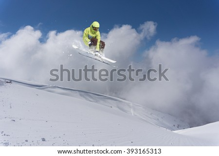 Flying skier on mountains. Extreme sport. - stock photo