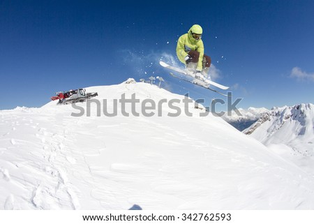 Flying skier on mountains. Extreme winter sport. - stock photo