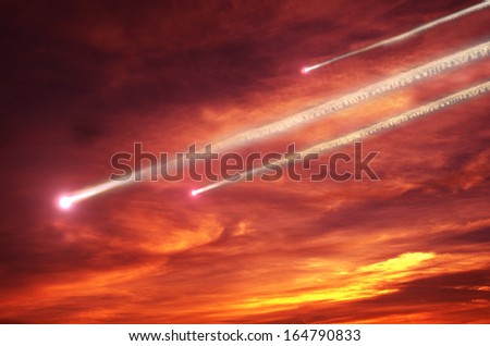 flying smoky meteors on background of sky - stock photo