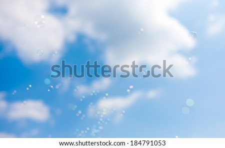 flying soap bubbles in the sky - stock photo