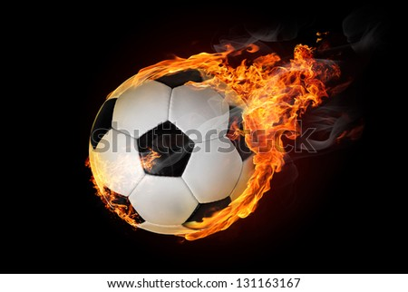 Flying soccer ball on fire -falling down - stock photo