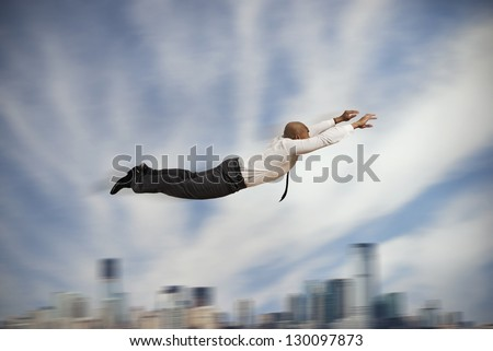 Flying super hero businessman concept of power in business - stock photo