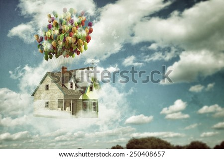 flying wooden house in the blue sky - stock photo