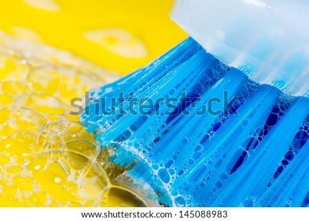 foam brush on yellow background - stock photo