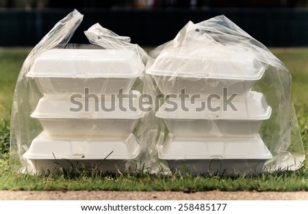 foam containers in clear plastic bags - stock photo
