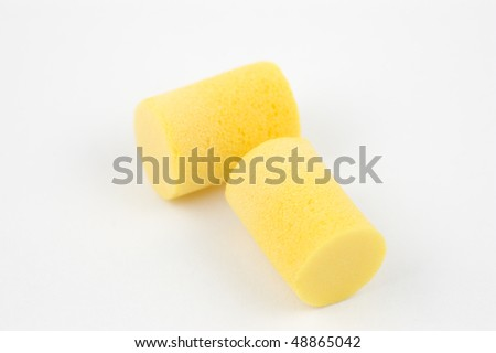 Foam earplugs on a white background - stock photo