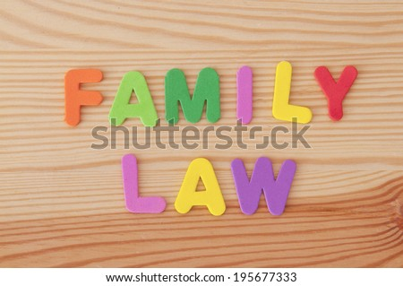 Foam letters spelling out Family Law on a wooden background - stock photo
