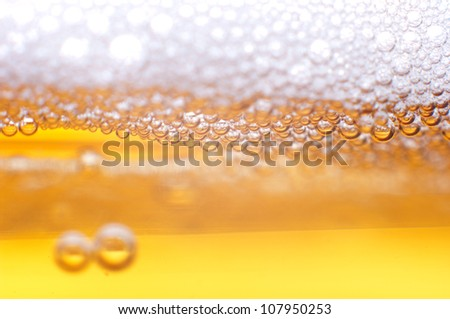 Foam on a light beer. - stock photo