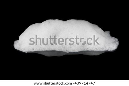 Foam on black background - stock photo