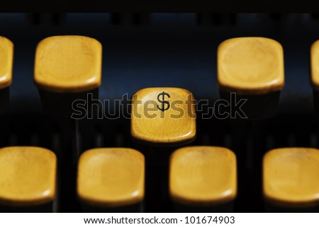 focus american dollar sign on old Typewriter keyboard., concept trading business  or  shopping - stock photo