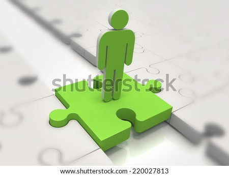 Focus on a person in green on a jigsaw piece - stock photo