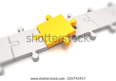 Focus on a yellow puzzle pieces over white background - stock photo