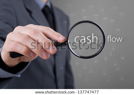 Focus on cash flow and audit of accounts concept. Businessman (auditor) analyze cash flow. Positive numbers fly up, negative numbers fly down.  - stock photo