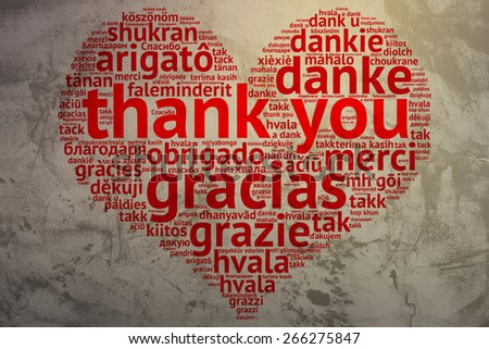 focus on English: Thank you. Word cloud in heart shape on Grunge Background. saying thanks in multiple languages. - stock photo
