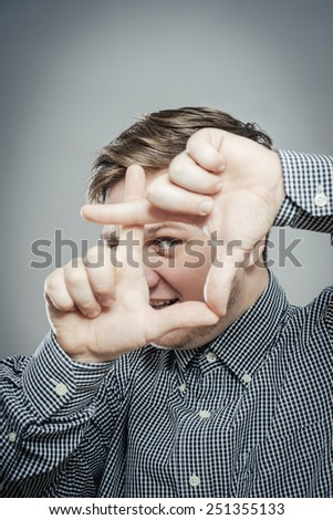 Focus on frame that executive is making with his hands - stock photo