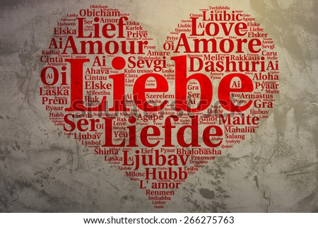 Focus on German: Liebe. Word cloud in heart shape on Grunge Background. saying thanks in multiple languages. - stock photo