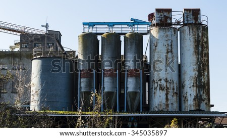 Focus on old abandoned industrial building - stock photo