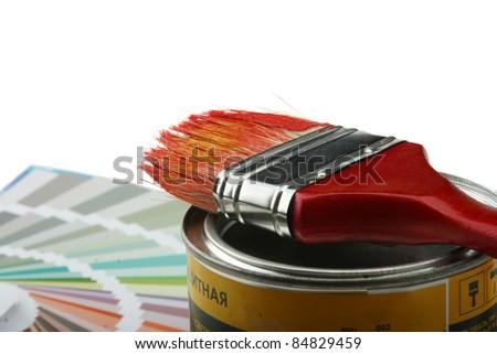 Focus on paintbrush and brush on white background - stock photo