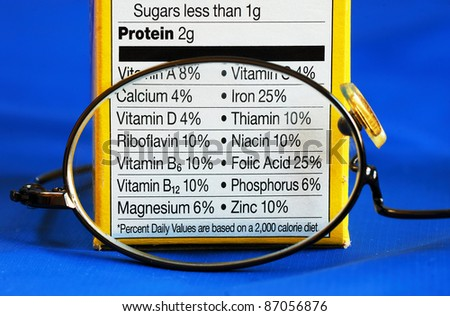 Focus on the nutrition facts from a box of food concepts of eat healthy - stock photo