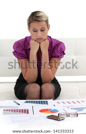 focused businesswoman analysing statistics - stock photo