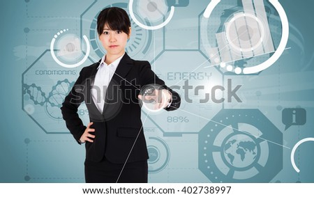 Focused businesswoman pointing against world map background - stock photo
