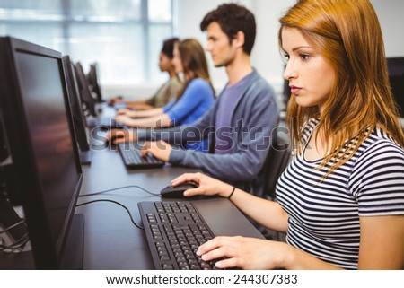 Focused student in computer class at the university - stock photo