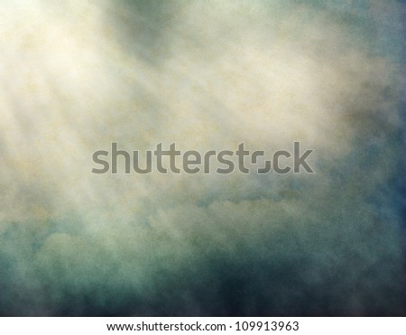 Fog and clouds with streaks of light and yellow-green retro colors.  Image displays a pleasing paper grain and texture at 100%. - stock photo