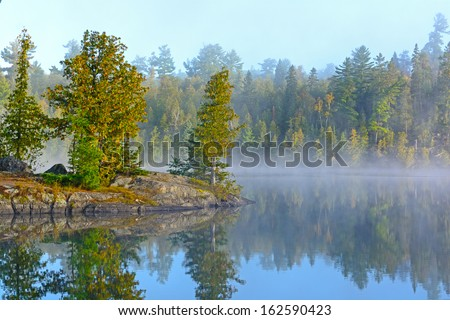 Fog and Mist on Ottertrack Lake in the Boundary Waters - stock photo