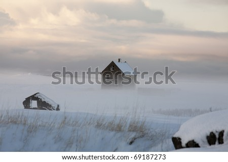 Fog and old house Iceland - stock photo