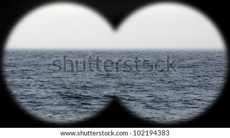 fog at sea seen through binoculars - stock photo