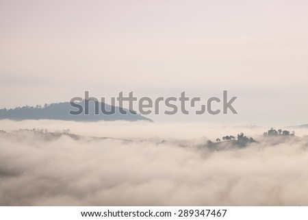Fog covered mountains and forest in the morning. Northern Thailand is cold and cool in the morning. - stock photo