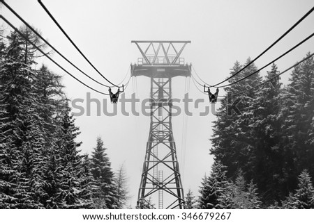 Fog in winter mountains. Black-and-white style. - stock photo