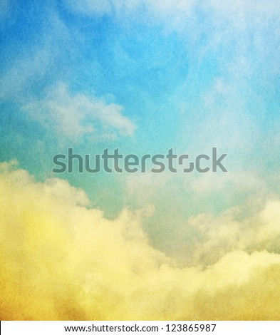 Fog, mist, and clouds with a yellow to blue gradient.  Image has a textured paper overlay and grain pattern visible at 100%. - stock photo