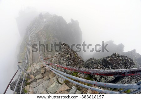 Fog on the mountain path - stock photo