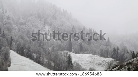 fog over the alps - stock photo