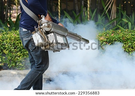 Fogging mosquito to prevent of dengue fever - stock photo