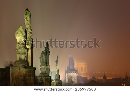 Foggy atmosphere with row of statues on the Charles bridge during night, Prague, Czech Republic - stock photo