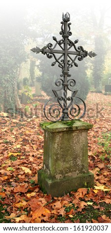 foggy autumn scenery at a graveyard in Schwaebisch Hall in Southern Germany - stock photo