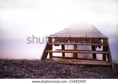 Foggy morning at elba island in winter - stock photo
