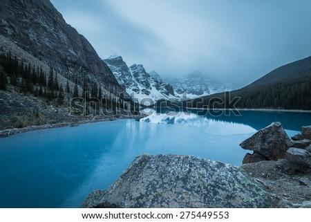 Foggy morning at Moraine Lake with for covering Ten Peak in the Canadian Rockies, Banff National Park, Alberta, Canada - stock photo