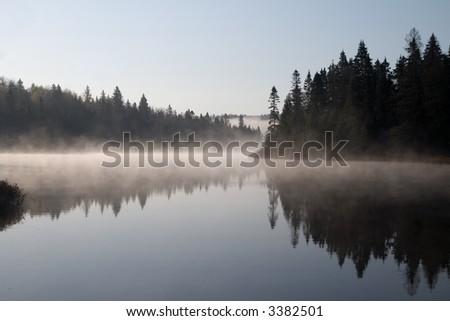 Foggy morning on the Mastigouche Nature Reserve - stock photo