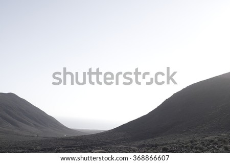 foggy mountain at sunrise - stock photo
