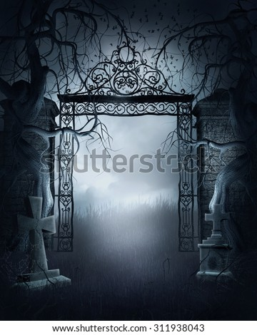 Foggy night scene with a cemetery gate, crosses and dark trees - stock photo