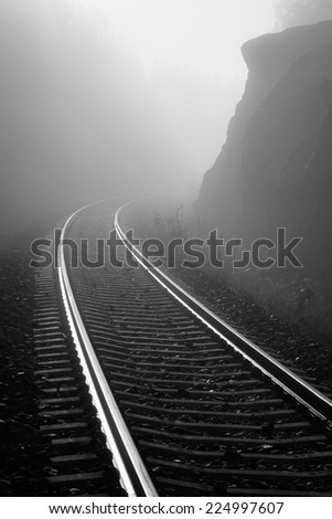 Foggy railway - stock photo