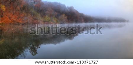 Foggy River Bank Foliage in High Dynamic Range - stock photo