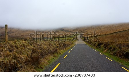 Foggy road in the ring of Kerry, Ireland - stock photo